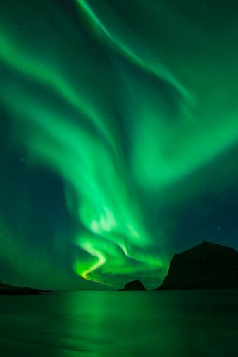 Northern Lights - Aurora Borealis shine in Sky over Vik Beach, Vestvagoy, Lofoten Islands, Norway - gettyimageskorea