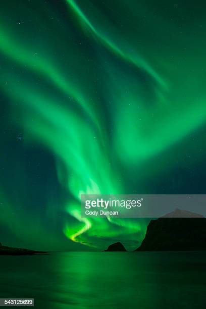 northern lights - aurora borealis shine in sky over vik beach, vestvagoy, lofoten islands, norway - aurora borealis stock pictures, royalty-free photos & images