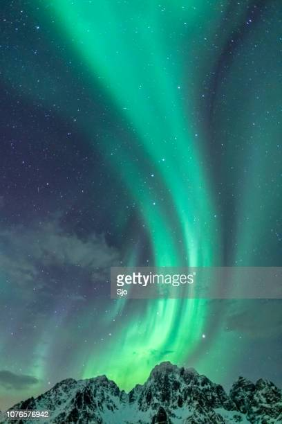 northern lights background image with mountain peaks and aurora - aurora borealis stock pictures, royalty-free photos & images