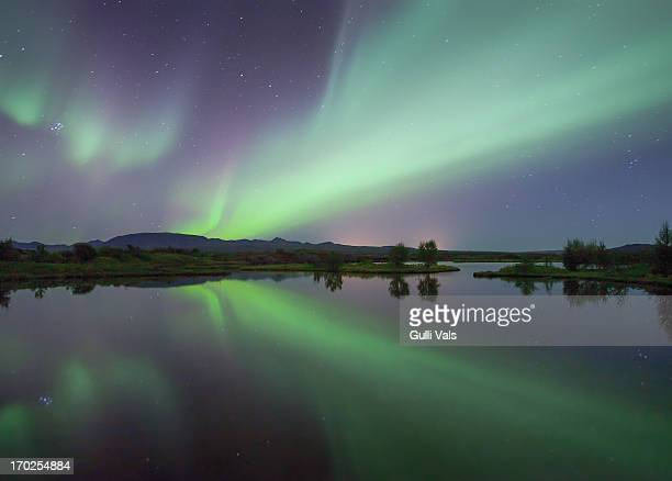 northern lights explosion - pingvellir national park stock photos and pictures