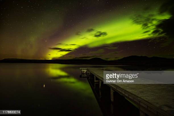 northern lights for thingvollar - gunnar örn árnason stock pictures, royalty-free photos & images
