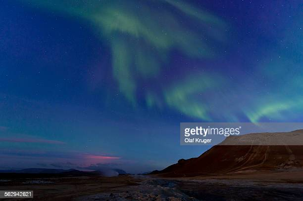 Northern lights, glow from a fissure eruption at the Holuhraun lava field, solfatara, fumaroles, sulphur and other minerals, steam, Hverarond high temperature or geothermal area, Namafjall mountains, Myvatn area, Northeastern Region, Iceland