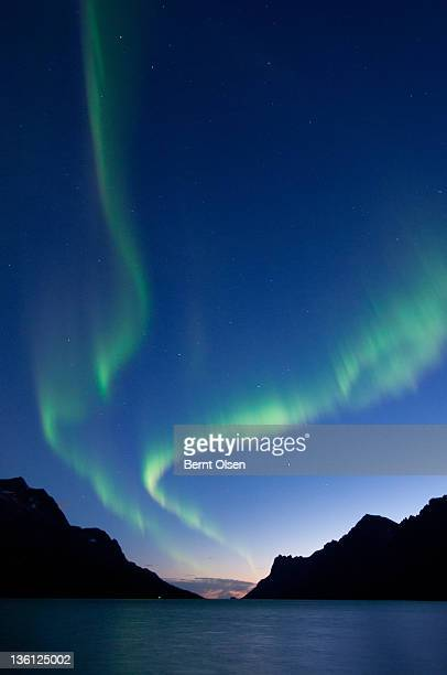 Northern Lights in Ersfjord between mountains