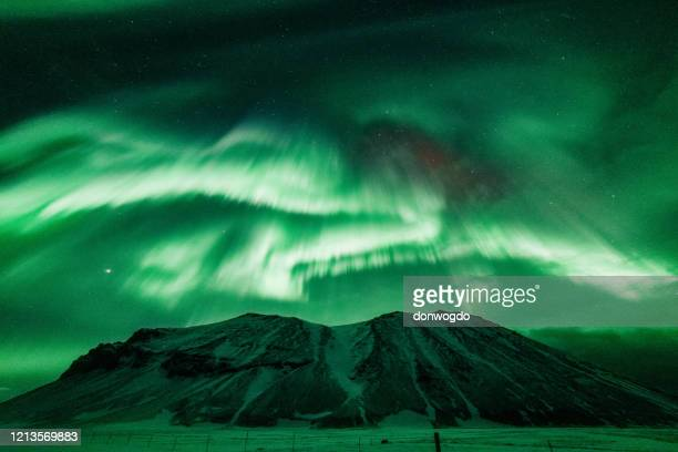 northern lights in iceland - space and astronomy stock pictures, royalty-free photos & images