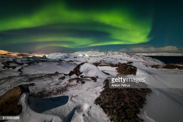 Northern lights in the snow-covered mountains