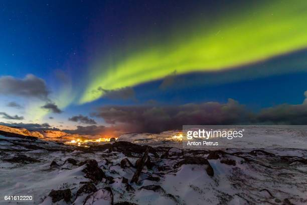 Northern lights in the snowy mountains in the Arctic