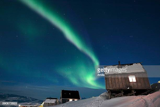 Northern lights in Tiniteqilaq in the district of Ammassalik in East Greenland