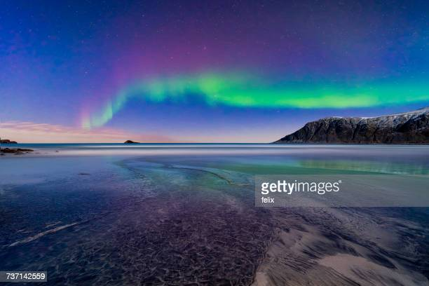 northern lights, lofoten, flakstad, nordland, norway - atmospheric mood stock pictures, royalty-free photos & images