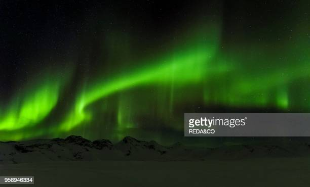 Northern Lights or aurora borealis over the mountains between Thingvellir and Laugarvatn during winter in Iceland Europe northern Europe Iceland...