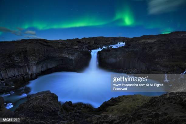 northern lights over Aldeyjarfoss waterfall in Iceland
