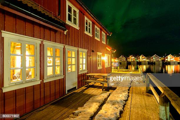 Northern lights over cabins Svolvaer harbor Lofoten, Norway