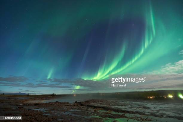 northern lights over geysir, golden circle, iceland - north stock pictures, royalty-free photos & images