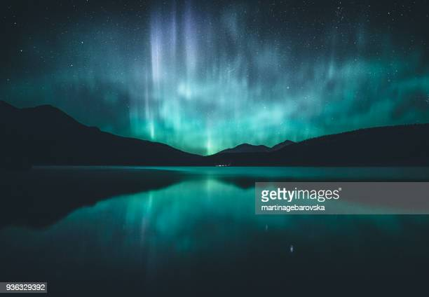 northern lights over lake, jasper, alberta, canada - aurora borealis stock pictures, royalty-free photos & images