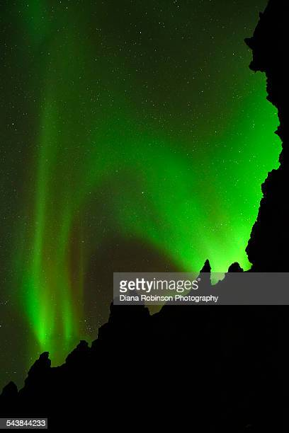 Northern Lights over lava rock formations