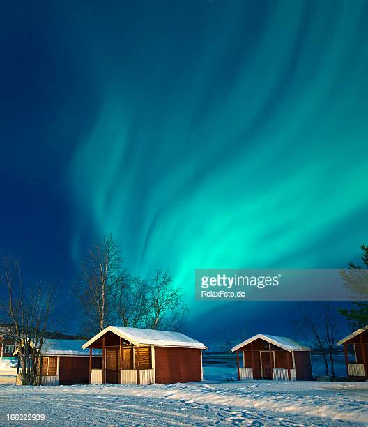 Northern lights (Aurora borealis) over Norwegian rorbuer in winter