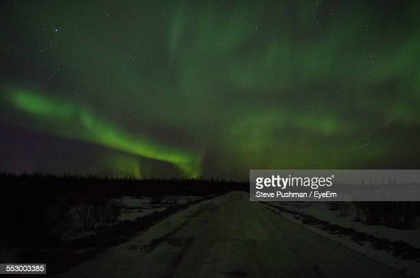 Northern Lights Over Snow Covered Road