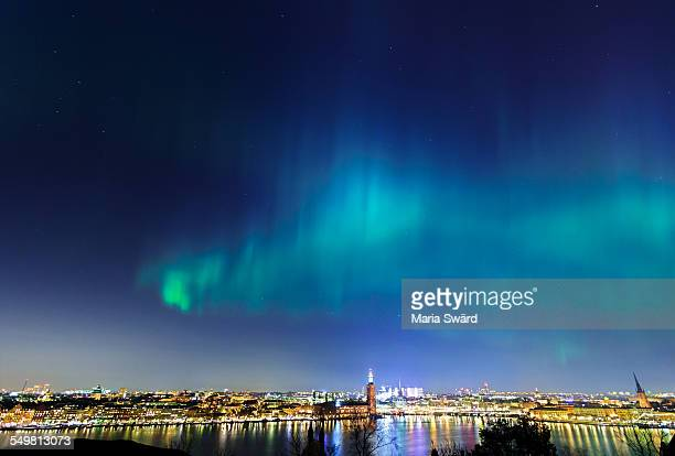 northern lights over stockholm city - marginata stock pictures, royalty-free photos & images