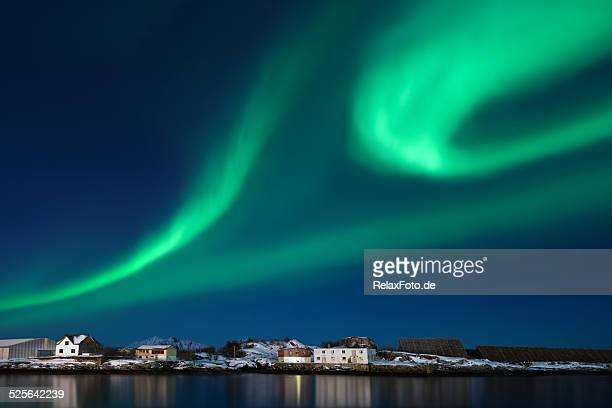 Northern lights (Aurora borealis) over Svolvaer harbor in winter