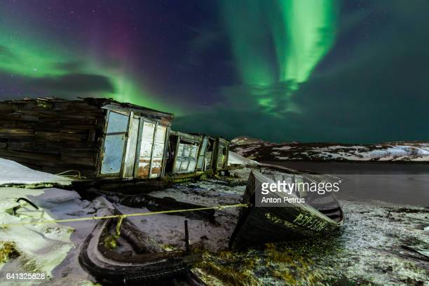 Northern lights over the fishing boat