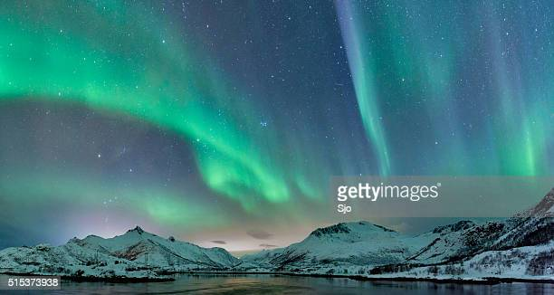 northern lights over the lofoten islands in norway - landscape scenery stock photos and pictures