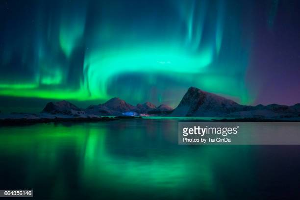 northern lights over the lofoten islands in norway - polar climate stock pictures, royalty-free photos & images