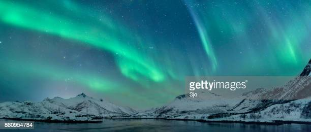 northern lights over the lofoten islands in norway - north stock pictures, royalty-free photos & images