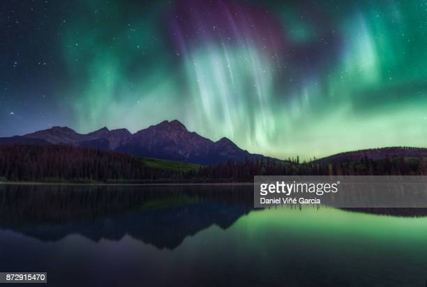 Northern Lights over the Patricia Lake in Jasper National Park, Alberta, Canada.
