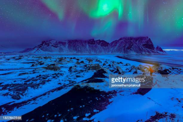 northern lights over vestrahorn mountain landscape, stokksnes peninsula, iceland - black sand stock pictures, royalty-free photos & images