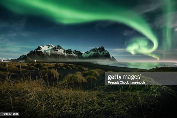 northern lights over vestrahorn moutain , iceland - iceland stock pictures, royalty-free photos & images
