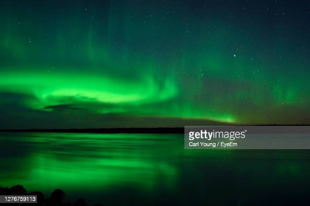 northern lights reflected in a canadian river - quebec stock pictures, royalty-free photos & images