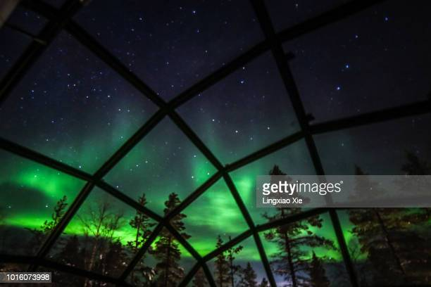 northern lights (aurora borealis) seen from glass igloos, saariselka, finland - igloo stock pictures, royalty-free photos & images