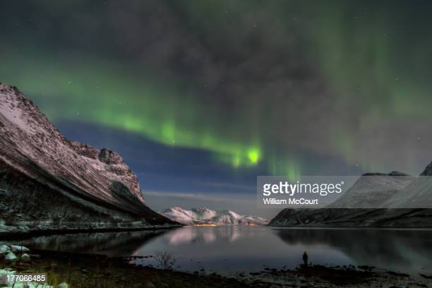 CONTENT] Northern lights taken near Grtfjord Troms Fylke The silhouette of our guide can be seen on the lake