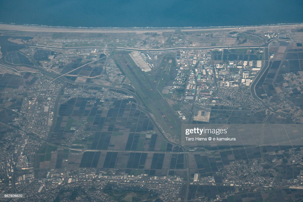Northern Pacific Ocean and Sendai International Airport in Japan sunset time aerial view from airplane : ストックフォト