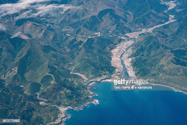 northern pacific ocean and tosashimizu city in kochi prefecture in japan daytime aerial view from airplane - kochi india stock pictures, royalty-free photos & images