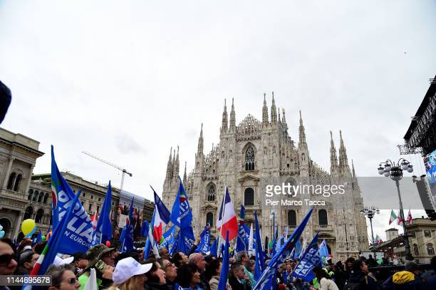 Northern Party League supporters wave flags during a demonstration ahead of the European elections in Piazza Duomo on May 18 2019 in Milan Italy
