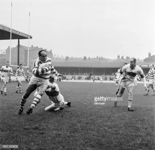 Northern Rugby Football League match at Central Park. Wigan Warriors v Wakefield Trinity. Billy Boston of Wigan is brought drown by Jack Wilkinson,...