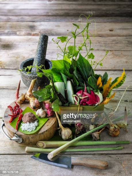 Northern Thai herbs, spices and vegetables for a Northern Thai traditional recipe called 'Gaeng Khae', which is a curry made of a seasonal mix of flowers and herbs, and can be cooked with free range chicken or pork.