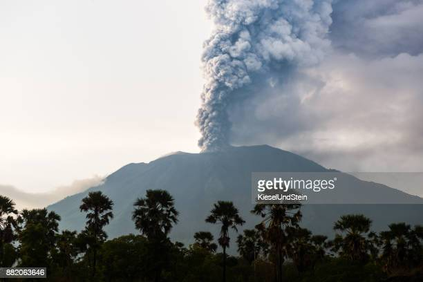 northern view on eruption of bali volcano mount agung - volcano stock photos and pictures