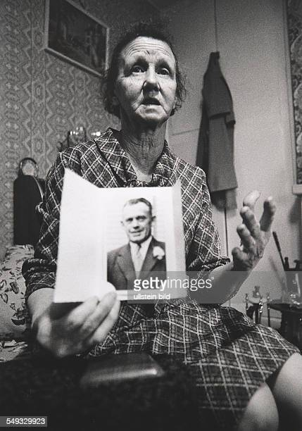 NorthernIreland County Armagh protestant woman shows photograph of her husband killed by IRA