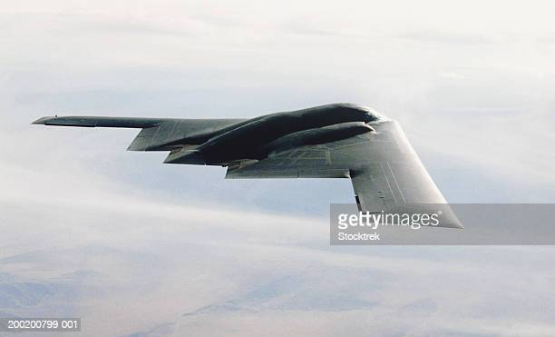 northrop b-2 stealth bomber in flight during training mission - stealth bomber stock photos and pictures