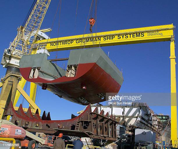 Northrop Grumman riggers utilized gantry cranes to lift a 189ton section that completes the stern end of the National Security Cutter Bertholf in...