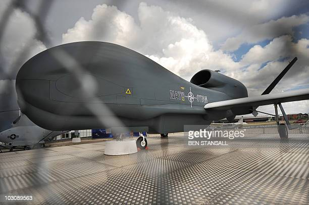 A Northrop Grumman RQ4 Global Hawk unmanned aircraft is pictured at the Farnborough International Airshow in Hampshire southern England on July 22...