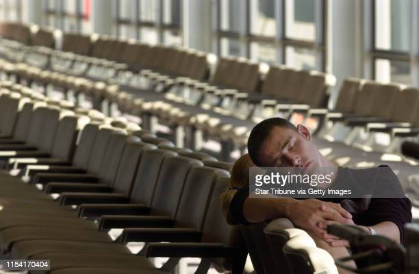 Northwest Airlines---- Trevor Patterson of, Donegal Ireland takes a nap at the gate in the F concourse at the Minneapolis St. Paul international...