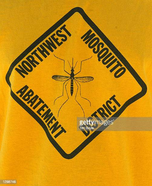 Northwest Mosquito Abatement District logo is seen on a worker's tshirt August 7 2002 in Niles Illinois According to the federal Centers for Disease...