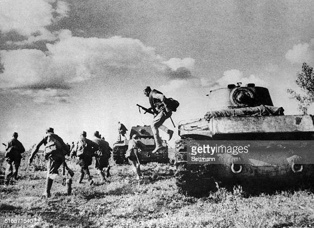 Northwest of Stalingrad, tank borne infantry leap from their carriers to attack the Nazi troops now on the defensive. The tanks then cover the ground...
