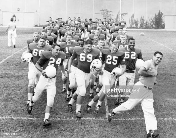 Northwestern football coach Ara Parseghian leads his team onto the field at Dyche Stadium on Aug 31 1962 in Evanston Ill