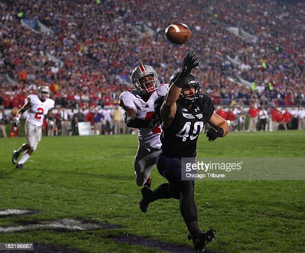 Northwestern fullback Dan Vitale is unable to catch a ball in the end zone as Ohio State safety C.J. Barnett defends in the first quarter at Ryan...