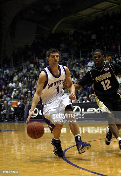 Northwestern Guard Jason Okrzesik dribbles the ball while being guarded by Purdue's Tarrance Crump at WelshRyan Arena in Evanston Illinois February...