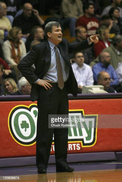 Northwestern Head Coach Bill Carmody instructs his defense during a game against the Indiana Hoosiers at WelshRyan Arena in Evanston Illinois on...