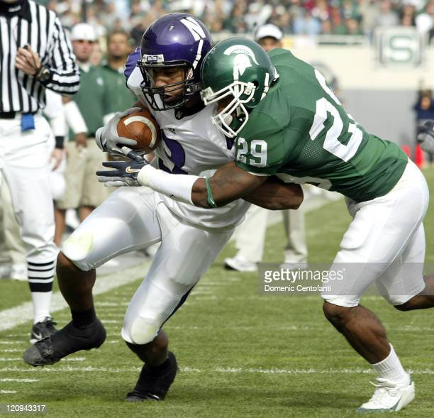 Northwestern junior wide receiver Shaun Herbert gets tackled by Michigan State's Greg Cooper in the first at Spartan Stadium East Lansing Michigan...